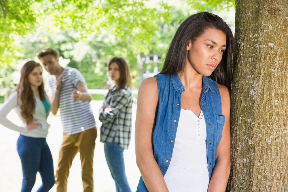 A teenage girl being excluded by her peers.